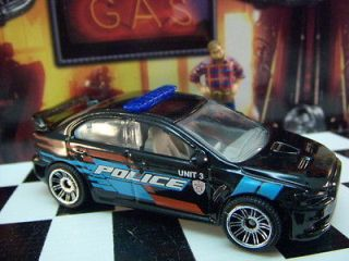 12 MATCHBOX MITSUBISHI LANCER EVOLUTION X POLICE CAR MINT LOOSE 164