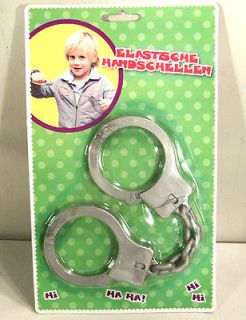 TRICK MAGIC RUBBER HANDCUFF toy keys joke gag fun NEW play wrist
