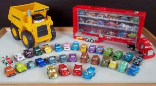 DISNEY PIXAR CARS MICRO DRIFTERS LOT MACK COLOSSUS TRUCK 32 CARS