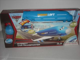 NEW DISNEY CARS 2 REMOTE CONTROL EVERETT CAR TRANSPORTER RC PLANE JET