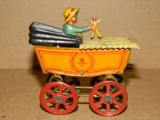 German Meier Tin Litho Penny Toy Baby w Doll in Stroller Wheels Roll